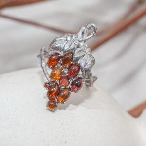 Золотое кольцо с бриллиантами и гранатами